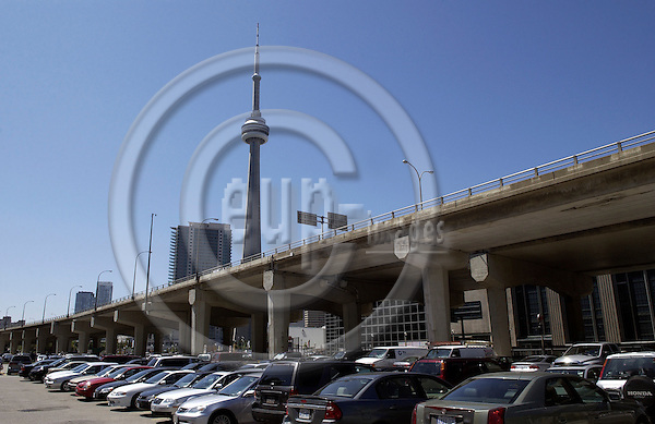 Toronto, Ontario, Canada - 08 August 2006 -- CN Tower and Gardiner Expressway on pylons above parking cars -- landmark, infrastructure, architecture -- Photo: Horst Wagner / eup-images