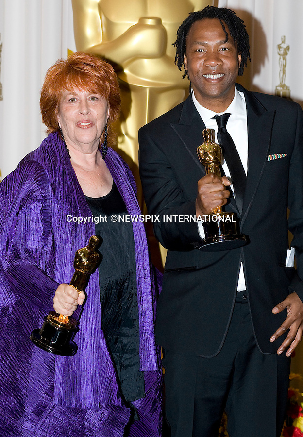 """Elinor Burkett and Roger Ross Williams, winners of Best Documentary Short.OSCARS 2010 PHOTOROOM.The 82nd Academy Awards_Kodak Theatre, Hollywood, Los Angeles_07/03/2009.Mandatory Photo Credit: ©Dias/Newspix International..**ALL FEES PAYABLE TO: """"NEWSPIX INTERNATIONAL""""**..PHOTO CREDIT MANDATORY!!: NEWSPIX INTERNATIONAL(Failure to credit will incur a surcharge of 100% of reproduction fees)..IMMEDIATE CONFIRMATION OF USAGE REQUIRED:.Newspix International, 31 Chinnery Hill, Bishop's Stortford, ENGLAND CM23 3PS.Tel:+441279 324672  ; Fax: +441279656877.Mobile:  0777568 1153.e-mail: info@newspixinternational.co.uk"""