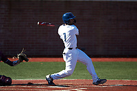 Justin Guy (1) of the Wingate Bulldogs follows through on his swing against the Concord Mountain Lions at Ron Christopher Stadium on February 2, 2020 in Wingate, North Carolina. The Mountain Lions defeated the Bulldogs 12-11. (Brian Westerholt/Four Seam Images)