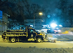 Merrick, New York, USA. 24rd January 2016. Two Town of Hempstead snowplows, a small one plowing out a cul de sac, dead end side street, and a large plow on the bigger road leading to it, are clearing roads while Blizzard Jonas continues to bring dangerous snow and gusting winds to Long Island. Governor Cuomo banned travel, shutting down L.I.'s roads and railroads, due to hazardous conditions, and the winter Storm of 2016 has already dropped about two feet of snow on the south shore town.
