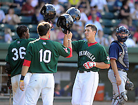 Infielder Nick Natoli (12) of the Greenville Drive, right, is congratulated by Jose Vinicio (36) and Blake Swihart (10) after hitting a rome run in a game against the Rome Braves on May 6, 2012, at Fluor Field at the West End in Greenville, South Carolina. Greenville won, 11-3. (Tom Priddy/Four Seam Images)