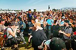 Rapper Action Bronson climbed the barriers to his fans at Weekend 1 of the Coachella Valley Music and Arts Festival in Indio, California April 10, 2015. (Photo by Kendrick Brinson)