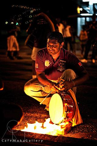 Hosay - Muslim festival. Heating the drumskin