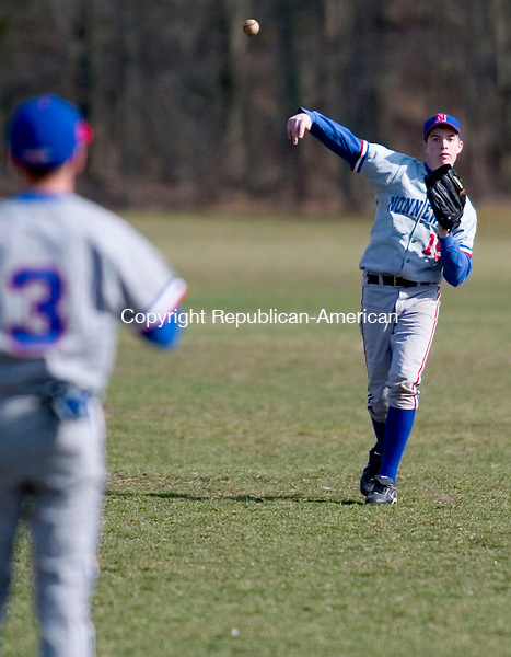 WOODBURY, CT- 11 APRIL 07- 041107JT18- <br /> Nonnewaug's Billy Drakeley, left, and John de Dufour warm up at Wednesday's game at Nonnewaug.<br /> Josalee Thrift Republican-American
