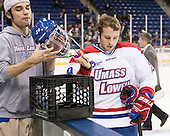 Ryan Ward (UML - Manager), Derek Arnold (UML - 29) - The University of Massachusetts Lowell River Hawks defeated the visiting American International College Yellow Jackets 6-1 on Tuesday, December 3, 2013, at Tsongas Arena in Lowell, Massachusetts.