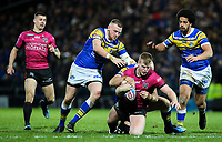 Hull FC 's Brad Fash is tackled by Leeds Rhinos' Carl Ablett<br /> <br /> Photographer Alex Dodd/CameraSport<br /> <br /> Betfred Super League Round 5 - Leeds Rhinos v Hull FC - Thursday 8th March 2018 - Headingley Carnegie Stadium - Leeds<br /> <br /> World Copyright &copy; 2018 CameraSport. All rights reserved. 43 Linden Ave. Countesthorpe. Leicester. England. LE8 5PG - Tel: +44 (0) 116 277 4147 - admin@camerasport.com - www.camerasport.com
