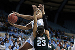 25 March 2014: North Carolina's Xylina McDaniel (34) shoots over Michigan State's Aerial Powers (23). The University of North Carolina Tar Heels played the Michigan State University Spartans in an NCAA Division I Women's Basketball Tournament First Round game at Cameron Indoor Stadium in Durham, North Carolina. UNC won the game 62-53.