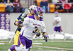 University at Albany Men's Lacrosse defeats Drexel 18-5 on Feb. 24 at Casey Stadium.  T.D. Ierlan carries one of his 20 won faceoffs. (Bruce Dudek / Eclipse Sportswire)