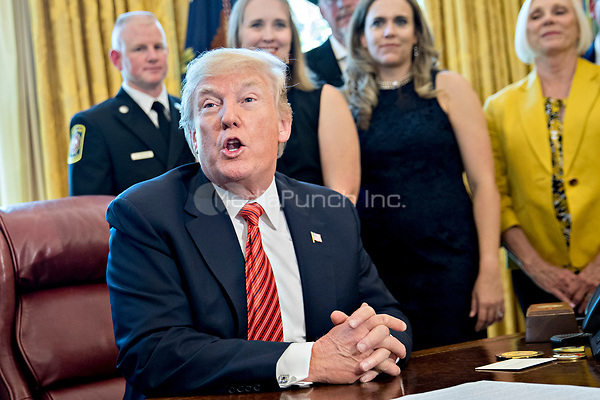 United States President Donald Trump responds to a question while meeting with the crew and passengers of Southwest Airlines Co. flight 1380 in the Oval Office of the White House in Washington, D.C., U.S., on Tuesday, May 1, 2018. An engine on Southwest's flight 1380, a Boeing Co. 737-700 bound for Dallas from New York's LaGuardia airport, exploded and made an emergency landing on April 17 sending shrapnel into the plane and killing a passenger seated near a window. <br /> Credit: Andrew Harrer / Pool via CNP /MediaPunch