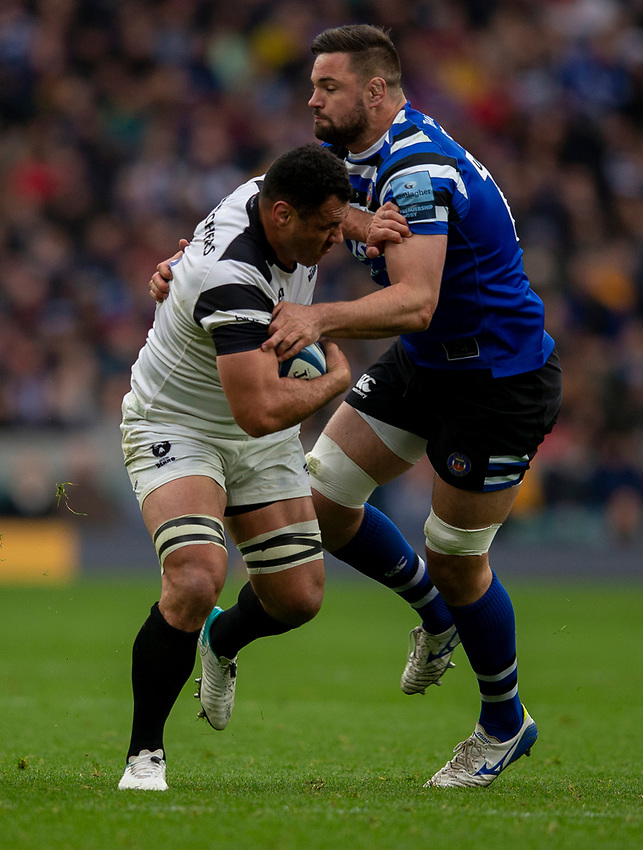 Bristol Bears' George Smith is tackled by Bath Rugby's Elliott Stooke<br /> <br /> Photographer Bob Bradford/CameraSport<br /> <br /> Gallagher Premiership - Bath Rugby v Bristol Bears - Saturday 6th April 2019 - The Recreation Ground - Bath<br /> <br /> World Copyright © 2019 CameraSport. All rights reserved. 43 Linden Ave. Countesthorpe. Leicester. England. LE8 5PG - Tel: +44 (0) 116 277 4147 - admin@camerasport.com - www.camerasport.com