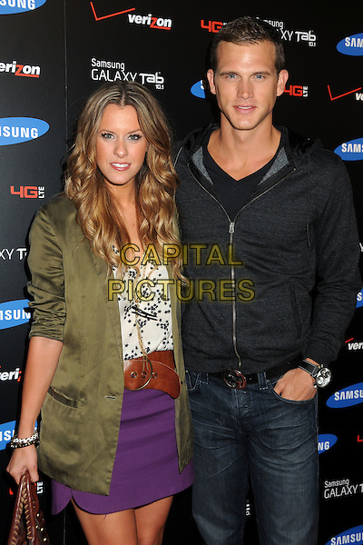 Courtney Kerr and Matt Nordgren.Samsung Galaxy Tab Launch Event Hosted by Samsung and Verizon held at The Beverly, West Hollywood, California, USA..August 2nd, 2011.half length purple skirt green jacket white top black .CAP/ADM/BP.©Byron Purvis/AdMedia/Capital Pictures.