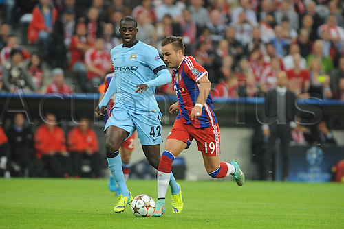 17.09.2014, Allianz arena, Munich, Germany.  Champions League, FC Bayern Munich versus  Manchester City. Yaya Toure (Manchester City) and Mario Goetze (FC Bayern Munich)