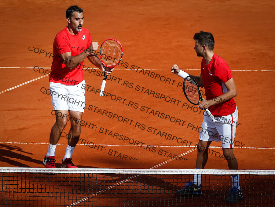 BELGRADE, SERBIA - JULY 16: Filip Krajinovic (R) and Nenad ZImonjic (L) of Serbia celebrate a point in the doubles match against Jamie Murray and Dominic Inglot of Great Britain during day two of the Davis Cup Quarter Final match between Serbia and Great Britain on Stadium Tasmajdan on July 16, 2016 in Belgrade, Serbia. (Photo by Srdjan Stevanovic/Getty Images)