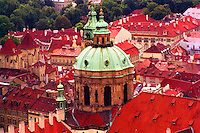 The dome and bell-tower of St. Nicholas' church (1702) rise above the Mala Strana section of Prague (Czech Republic)