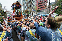 People carry a mikoshi featuring a large iron phallus during the Kanamara festival for the steel phallus in Kawasaki Daishi, Kanagawa, Japan. Sunday April 5th 2015 The Kanamara penis festival celebrates a legend about the defeat of a penis-eating demon. It is a wildly popular festival attracting large numbers of locals and foreigners.