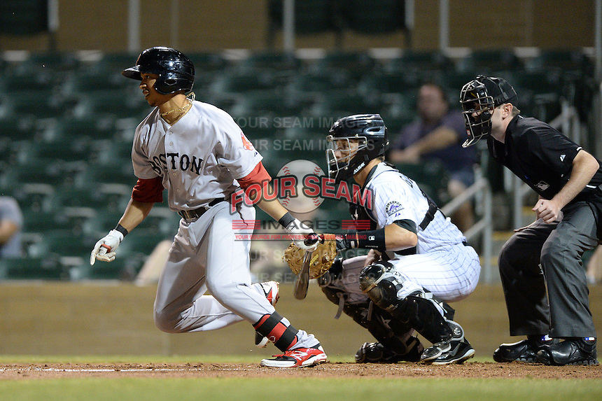 Surprise Saguaros second baseman Mookie Betts (16), of the Boston Red Sox organization, at bat in front of catcher Dustin Garneau and umpire Jeff Morrow during an Arizona Fall League game against the Salt River Rafters on October 15, 2013 at Salt River Fields at Talking Stick in Scottsdale, Arizona.  Surprise defeated Salt River 9-2.  (Mike Janes/Four Seam Images)