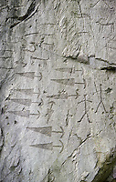 Prehistoric  petroglyphs, rock carvings, in an ancient snctuary carved by the the ancient Camuni people in the Copper Age around the 3rd milleneum BC  , Massi dei Cemmo Archaeological Site, Capo di Ponti, Lombardy Italy