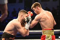 Danny Dignum (red shorts) defeats Conrad Cummings during a Boxing Show at York Hall on 9th November 2019