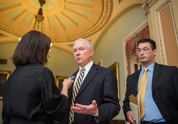UNITED STATES - MAY 21: Sen. Jeff Sessions, R-Ala., speaks with a reporter in the Ohio Clock Corridor before the Senate policy luncheons in the Capitol on Tuesday, May 21, 2013. (Photo by Bill Clark/CQ Roll Call)