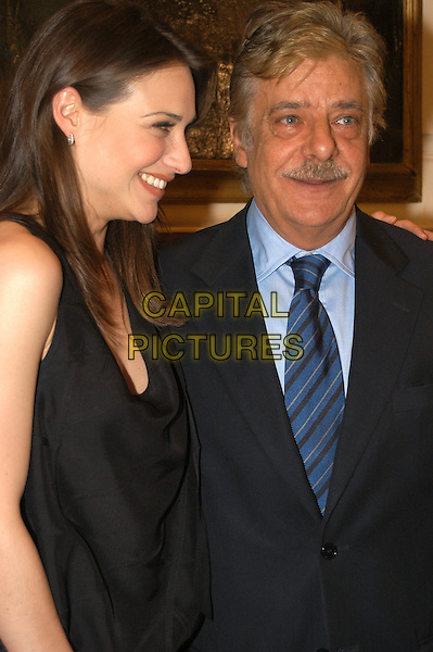"CLAIRE FORLANI & GIANCARLO GIANNINI.At the photocall for movie ""The Shadow Dancer"".Rome, Italy.30th April 2004.half length half length .www.capitalpictures.com.sales@capitalpictures.com.©Capital Pictures"