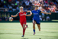 Seattle, WA - Saturday August 26, 2017: Emily Sonnett, Katlyn Johnson during a regular season National Women's Soccer League (NWSL) match between the Seattle Reign FC and the Portland Thorns FC at Memorial Stadium.