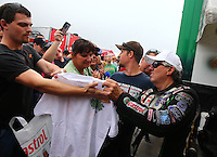 Oct 6, 2013; Mohnton, PA, USA; NHRA funny car driver John Force signs autographs during the Auto Plus Nationals at Maple Grove Raceway. Mandatory Credit: Mark J. Rebilas-