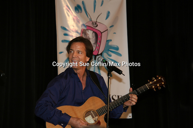 Bradley Cole sings -  So Long Springfield event brought out Guiding Light Actors as they  came to see fans at the Hyatt Regency in Pittsburgh, PA. for Q & A, acting scenes between actors and fans, and entertainment (singing) by GL finest during the weekend of October 24 and 25, 2009. (Photo by Sue Coflin/Max Photos)