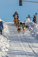 Anna Berington on Cordova St. hill during the Anchorage start day of Iditarod 2018 on Cordova St. hill during the Anchorage start day of Iditarod 2019