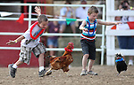 Joseph Brandt, left, and Oscar Karis compete in the chicken race at the International Camel Races in Virginia City, Nev., on Friday, Sept. 9, 2011. .Photo by Cathleen Allison