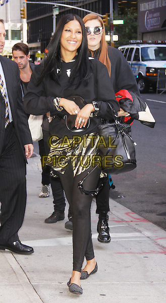 Aino Jawo and Caroline Hjelt of Icona POP at the Ed Sullivan Theater for an appearance on Late Show with David Letterman in New York City, USA.<br /> September 25th, 2013 <br /> full length black top jeans denim sunglasses shades leggings  <br /> CAP/MPC/RW<br /> &copy;RW/ MediaPunch/Capital Pictures