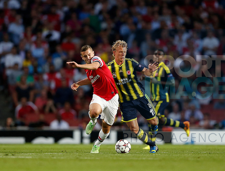 Arsenal's Jack Wilshere tussles with Fenerbahce's Dirk Kuyt<br /> <br /> Arsenal v Fenerbahce  - UEFA Champions League - Play-off Second Leg - Emirates Stadium - London - England -27/08/2013  - Pic David Klein/Sportimage