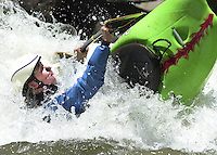 A kayaker competes in a rodeo competition in the Animas River in Durango, Colorado in June 2003.