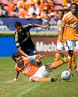 Houston Dynamo defender Mike Chabala (17) slide tackles the ball away from Los Angeles Galaxy defender Sean Franklin (28). Houston Dynamo tied Los Angeles Galaxy 0-0 at Robertson Stadium in Houston, TX on October 18, 2009.
