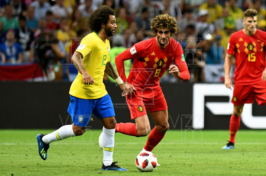 KAZAN - RUSIA, 06-07-2018: MARCELO (Izq) jugador de Brasil disputa el balón con Marouane FELLAINI (Der) jugador de Bélgica durante partido de cuartos de final por la Copa Mundial de la FIFA Rusia 2018 jugado en el estadio Kazan Arena en Kazán, Rusia. / MARCELO (L) player of Brazil fights the ball with Marouane FELLAINI (R) player of Belgium during match of quarter final for the FIFA World Cup Russia 2018 played at Kazan Arena stadium in Kazan, Russia. Photo: VizzorImage / Julian Medina / Cont