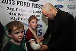 Paul McGrath with Harry and Charlie Murphy at the Launch of the Monster Car Draw in aid of the Gary Kelly Centre at Smiths Garage....Photo NEWSFILE/Jenny Matthews.