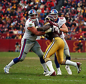Landover, MD - December 8, 2002 -- New York Giants offensive tackle Luke Petitgout (77) and tight end Jeremy Shockey (80) block Washington Redskins defensive end Bruce Smith (78) in fourth quarter action in Landover, Maryland.  The Giants won the game 27 - 21..Credit: Ron Sachs / CNP.[NOTE: No New York Metro or other Newspapers within a 75 mile radius of New York City]