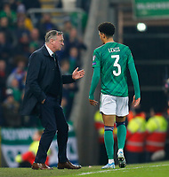 16th November 2019; Windsor Park, Belfast, Antrim County, Northern Ireland; European Championships 2020 Qualifier, Northern Ireland versus Netherlands; Michael O'Neill Norther Ireland coach had a word with Jamal Lewis of Northern Ireland - Editorial Use