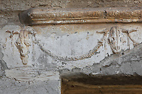 Skulls of goats and garlands above the entrance to the Terme dei Sette Sapienti (Baths of the Seven Sages), 2nd century AD, Ostia Antica, Italy. Picture by Manuel Cohen