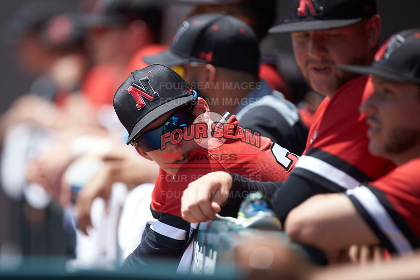 Josh Winkler (20) of the Northeastern Huskies hangs over the dugout railing during the game against the North Carolina State Wolfpack at Doak Field at Dail Park on June 2, 2018 in Raleigh, North Carolina. The Wolfpack defeated the Huskies 9-2. (Brian Westerholt/Four Seam Images)