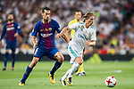 Luka Modric (r) of Real Madrid competes for the ball with Sergio Busquets Burgos of FC Barcelona during their Supercopa de Espana Final 2nd Leg match between Real Madrid and FC Barcelona at the Estadio Santiago Bernabeu on 16 August 2017 in Madrid, Spain. Photo by Diego Gonzalez Souto / Power Sport Images