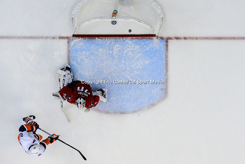 April 23, 2015 - Washington D.C., U.S. - New York Islanders right wing Kyle Okposo (21) watches a shot by left wing Josh Bailey (12) (not pictured) find the back of Washington Capitals goalie Braden Holtby's (70) net during game 5 of the  NHL Eastern Conference Quarter finals between the New York Islanders and the Washington Capitals held at the Verizon Center in Washington DC.  The Capitals defeat the Islanders 5-1 in regulation time to take the lead in the 7 game series 3-2. Eric Canha/CSM