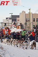 Musher Billy Snodgrass and Iditarider Courtney Cronin.leave the 2011 Iditarod ceremonial start line in downtown Anchorage, Alaska