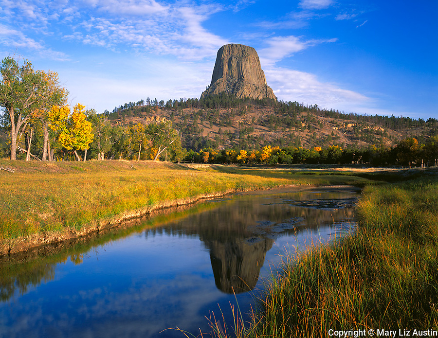 Devil's Tower National Monument, WY<br /> Devil's Tower in morning light rises above the valley of the Belle Fourche River in early fall