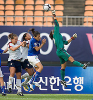 Italian goalkeeper (12) Anna Picarelli punches the ball away from USWNT teammates (8) Lauren Cheney and (16) Angela Hucles during the last group stage game at the Peace Queen Cup.  The USWNT defeated Italy, 2-0, at the Suwon Sports Center in Suwon, South Korea.