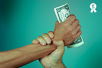 Man gripping woman's hand full of dollar banknotes, close-up (Licence this image exclusively with Getty: http://www.gettyimages.com/detail/sb10061763aa-001 )
