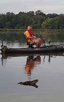NWA Democrat-Gazette/FLIP PUTTHOFF <br /> Logs and brush are abundant at Lake Sequoyah. All are potential crappie lairs. McBride fishes near a log Sept. 24 2015 on the south end of the lake.
