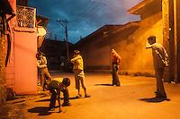 Srinagar, India-August 8, 2010: Kashmiri boys play in an alley during a curfew in downtown Srinagar