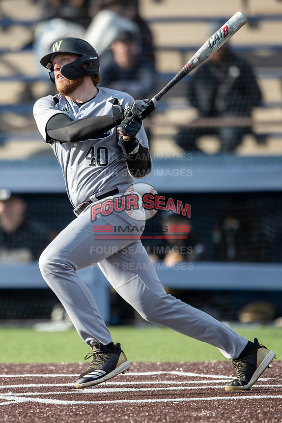 Western Michigan Broncos first baseman Sean O'Keefe (40) follows through on his swing against the Michigan Wolverines on March 18, 2019 in the NCAA baseball game at Ray Fisher Stadium in Ann Arbor, Michigan. Michigan defeated Western Michigan 12-5. (Andrew Woolley/Four Seam Images)