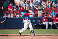 Spokane Indians catcher Isaias Quiroz (11) hits a home run during a Northwest League game against the Vancouver Canadians at Avista Stadium on September 2, 2018 in Spokane, Washington. The Spokane Indians defeated the Vancouver Canadians by a score of 3-1. (Zachary Lucy/Four Seam Images)