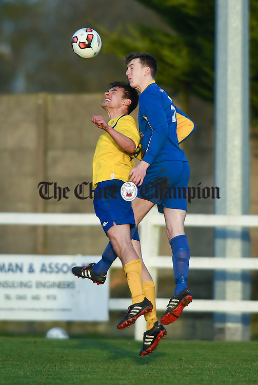 Ian Collins of  Clare  in action against Joe Woods of Roscommon during their Oscar Traynor game in Frank Healy park, Doora. Photograph by John Kelly.